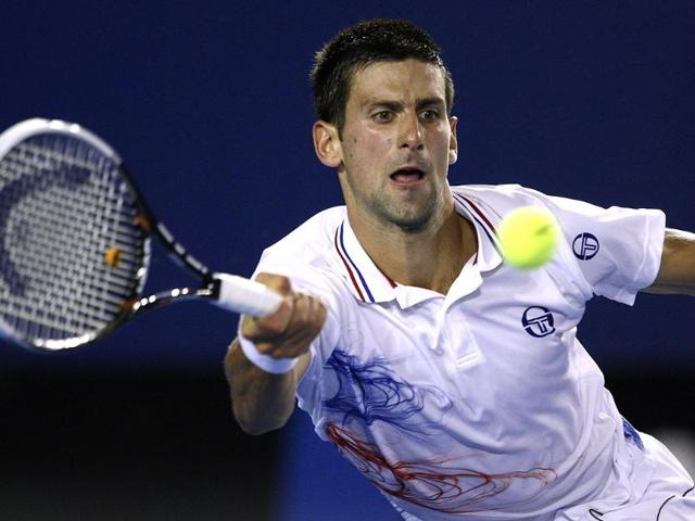 Novak-Djokovic-of-Serbia-hits-a-forehand-return-to-David-Ferrer-of-Spain-during-their-quarterfinal-at-the-Australian-Open-tennis-championship-in-Melbourne-AP-Photo-Rick-Rycroft