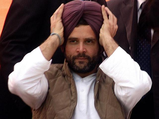 AICC-general-secretary-Rahul-Gandhi-adjusting-his-turban-which-was-presented-by-Youth-Congress-during-a-Congress-rally-at-Chogawan-in-Tarn-Taran-district-of-Punjab-on-Wednesday-Photo-by-Munish-Byala-HT
