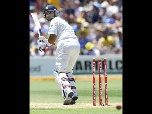 Virat-Kohli-R-of-India-celebrates-with-teammate-Wriddhiman-Prasanta-Saha-after-reaching-50-runs-during-the-third-day-of-their-fourth-Test-cricket-match-against-Australia-in-Adelaide-Reuters-Brandon-Malone