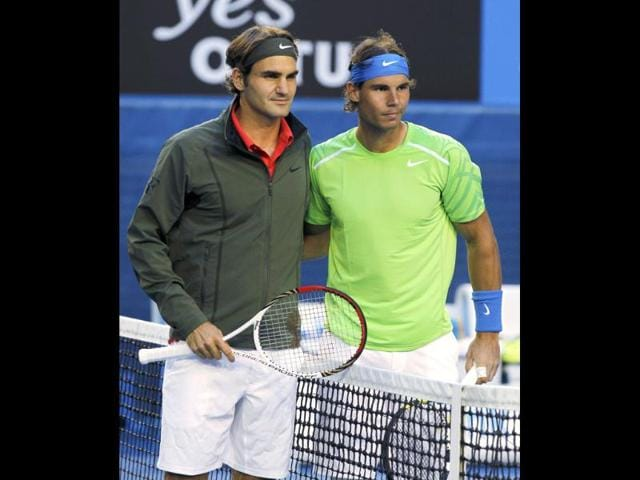 Rafael-Nadal-of-Spain-R-and-Roger-Federer-of-Switzerland-shake-hands-at-the-net-after-Nadal-won-their-semifinal-match-at-the-Australian-Open-tennis-championship-in-Melbourne-AP-Photo-Rick-Rycroft
