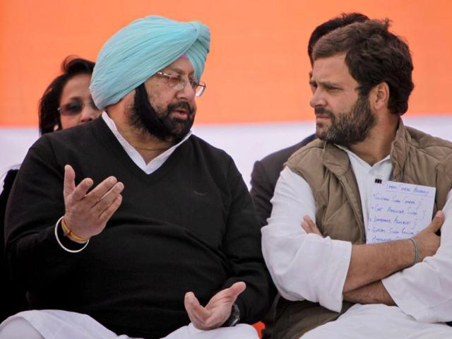 Congress-general-secretary-Rahul-Gandhi-speaks-with-former-chief-minister-of-Punjab-state-Captain-Amarinder-Singh-during-an-election-rally-in-Chabal-near-Amritsar-AP-Photo