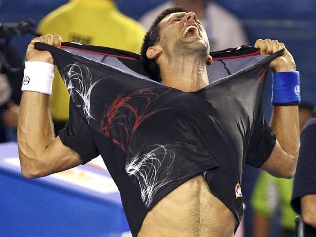 Novak-Djokovic-of-Serbia-celebrates-after-defeating-Rafael-Nadal-of-Spain-during-the-men-s-singles-final-at-the-Australian-Open-tennis-championship-in-Melbourne-Australia--AP-Photo-Rick-Rycroft