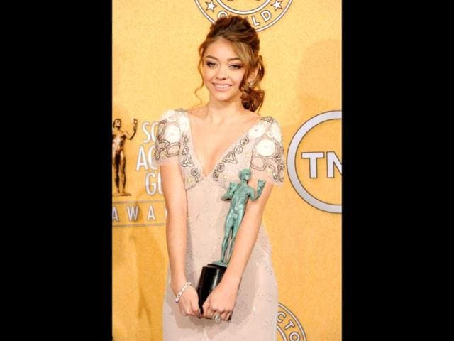 Actress-Sarah-Hyland-poses-in-the-press-room-during-the-18th-Annual-Screen-Actors-Guild-Awards-at-The-Shrine-Auditorium-on-January-29-2012-in-Los-Angeles-California-Getty-Images-AFP