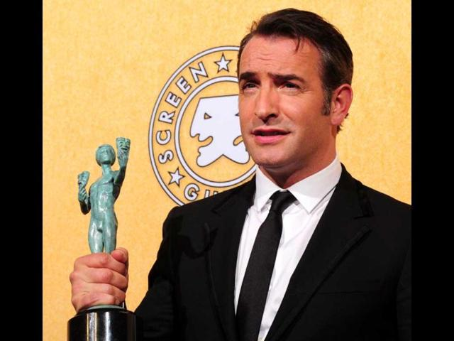 Jean-Dujardin-holds-his-award-for-outstanding-performance-by-a-male-in-a-leading-role-in-The-Artist-on-January-29-2012-in-the-press-room-during-the-18th-Annual-Screen-Actors-Guild-Awards-at-the-Shrine-Auditorium-in-Los-Angeles-California-AFP-Photo