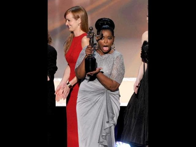 Actress-Octavia-Spencer-with-the-cast-of-The-Help-accept-the-Outstanding-Performance-by-a-Cast-in-a-Motion-Picture-award-onstage-during-the-18th-Annual-Screen-Actors-Guild-Awards-at-The-Shrine-Auditorium-in-Los-Angeles-California-Getty-Images-AFP