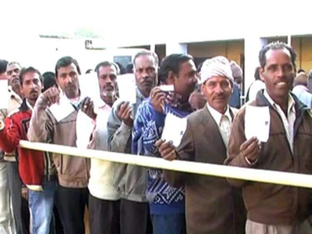 Voters-show-their-election-card-before-casting-their-votes-during-the-assembly-elections-in-Uttarakhand-ANI-Photo
