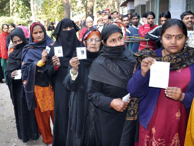 Burqa-clad-Muslim-women--show-their-voter-ID-card-while-lined-up-outside-a-polling-station-to-cast-their-vote-during-Uttarakhand-Assembly-polls-in-Dehradun-UNI-Photo