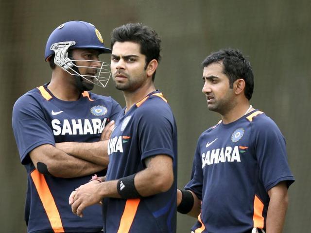 Cricketers-Praveen-Kumar-L-Virat-Kohli-C-and-Gautam-Gambhir-talk-during-net-practice-in-Sydney-AP-Photo-Rob-Griffith