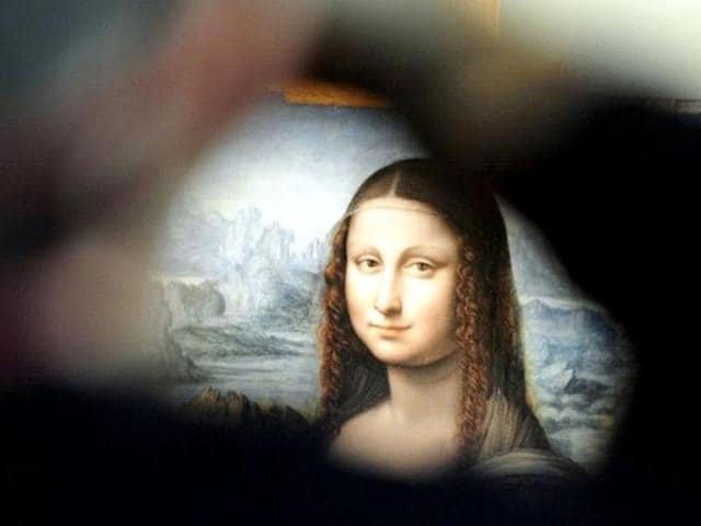 View-of-an-authenticated-contemporary-copy-of-Leonardo-da-Vinci-s-Mona-Lisa-presented-at-the-Prado-Museum-after-it-was-found-in-its-vaults-According-to-details-of-experts-findings-published-by-the-specialist-British-journal-The-Art-Newspaper-and-the-Spanish-media-the-work-is-a-copy-painted-in-Da-Vinci-s-studio-by-one-of-his-pupils-AFP-Photo-Javier-Soriano