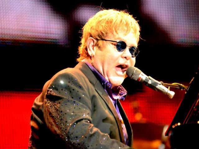 Legendary-English-singer-Elton-John-performs-with-his-band-during-his-latest-tour-at-the-Ricardo-Saprissa-Stadium-in-the-capital-city-of-San-Jose-Costa-Rica-AFP-PHOTO-Ezequiel-BECERRA