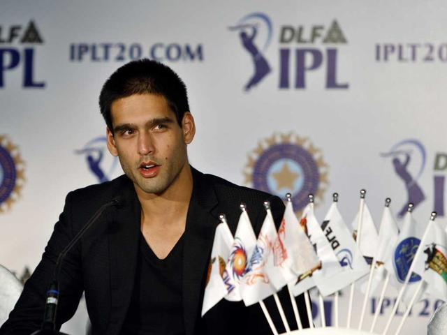 RCB-owner-Sidharth-Mallya-waves-during-the-Champions-league-T20-match-in-Bangalore