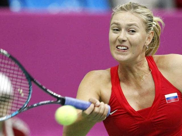 Russia-s-Maria-Sharapova-hits-a-return-to-Spain-s-Silvia-Soler-Espinosa-during-their-Fed-Cup-World-Group-first-round-tennis-match-in-Moscow-Reuters-Photo