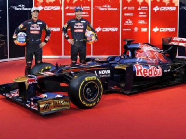 Daniel-Ricciardo-left-and-Jean-Eric-Vergne-with-the-new-Scuderia-Toro-Rosso-STR7-Photo-AFP