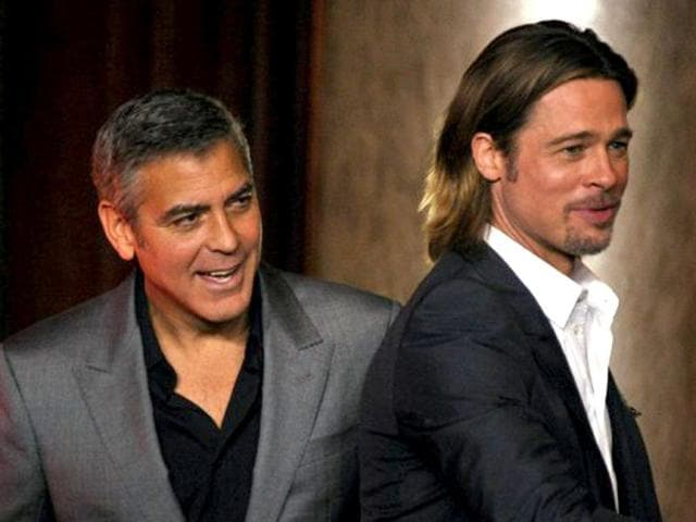 Competitors-George-Clooney-and-Brad-Pitt-clearly-look-up-to-no-good