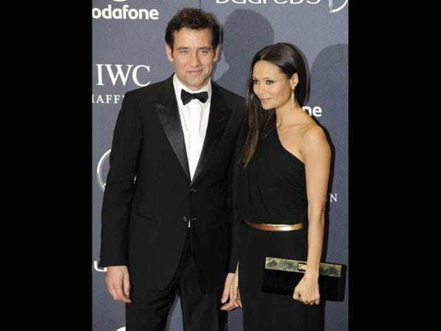 Actors-Clive-Owen-and-Thandie-Newton-pose-for-photographs-as-they-arrive-for-the-Laureus-World-Sports-Awards-2012-in-central-London-Reuters-Paul-Hackett