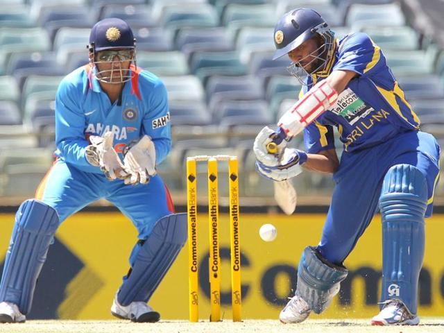 Tillakaratne-Dilshan-hits-to-the-boundary-watched-by-MS-Dhoni-during-the-match-against-India-in-the-Tri-Nations-ODI-cricket-series-at-the-WACA-ground-in-Perth-AFP