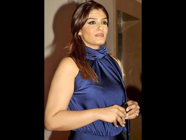 Raveena-Tandon-The-mast-mast-girl-of-the-90s-who-delivered-shy-smashing-hits-including-Laadla-Dilwale-Andaz-Apna-Apna-Mohra-Ghulam-E-Musthafa-Dulhe-Raja-is-shy-foraying-back-into-Bollywood-with-Anurag-Kashyap-s-Bombay-Velvet-this-year-One-of-the-most-successful-Bollywood-heroines-of-the-90s-Raveena-who-s-shy-married-to-film-distributor-Anil-Thadani-has-a-nine-year-old-daughter-Rasha-and-a-seven-year-old-boy-Ranbir-Known-for-her-oomph-she-will-play-a-shy-seductive-jazz-singer-from-the-60s-in-Kashyap-s-movie