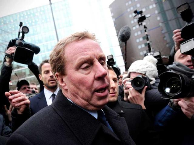 Tottenham-Hotspur-manager-Harry-Redknapp-foreground-and-his-son-Jamie-L-make-their-way-through-a-scrum-of-media-as-they-leave-Southwark-Crown-Court-in-London-AFP-photo-Carl-Court