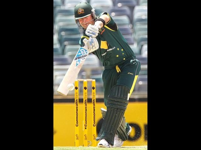 Michael-Clarke-drives-a-ball-during-the-Tri-Nations-ODI-Series-match-between-Australia-and-Sri-Lanka-at-the-WACA-ground-in-Perth-AFP
