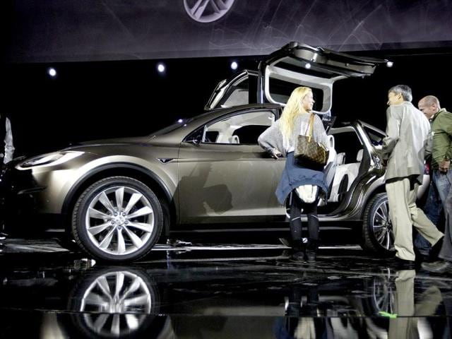 The Tesla Motors Model X electric vehicle is unveiled at the Tesla Design Studio in Hawthorne, California. Tesla Motors Inc on Thursday showed off a protoype of its Model X, a battery-powered SUV that represents the company's bet that consumers will buy a range of electric vehicles spun from a common platform. Reuters photo/David McNew