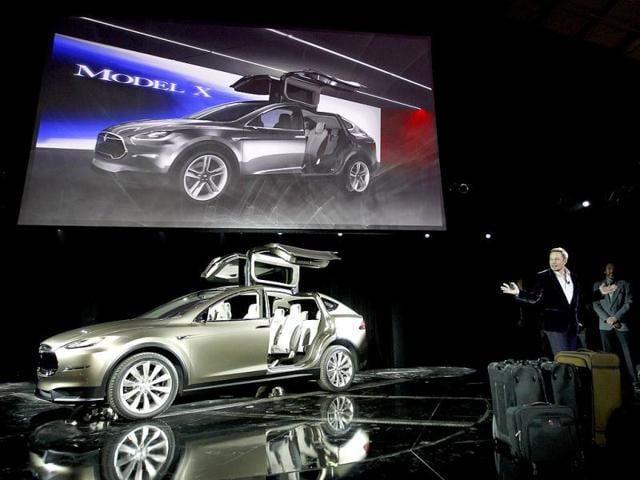 People look at the Tesla Motors Model X electric vehicle at its unveiling at the Tesla Design Studio in Hawthorne, California. Tesla Motors Inc on Thursday showed off a protoype of its Model X, a battery-powered SUV that represents the company's bet that consumers will buy a range of electric vehicles spun from a common platform.Reuters photo/David McNew