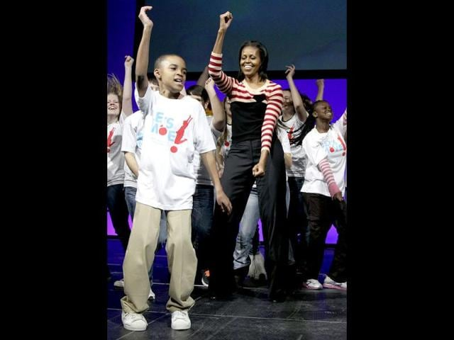US-First-lady-Michelle-Obama-does-the-Interlude-dance-with-kids-on-stage-during-a-Let-s-Move-event-with-children-from-Iowa-schools-AP-Carolyn-Kaster