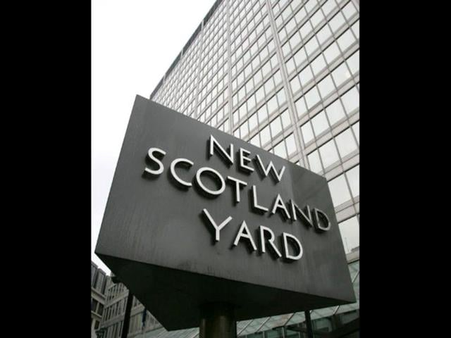 A-sign-revolves-outside-the-New-Scotland-Yard-office-in-London-AFP-Photo-File