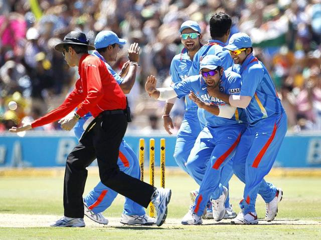 India-team--celebrates-the-run-out-of-Australia-s-David-Warner-during-their-one-day-international-cricket-match-in-Adelaide-Reuters-photo-Tim-Wimborne