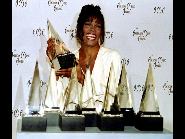Whitney-Houston-shows-off-the-seven-awards-she-won-February-7-at-the-21st-American-Music-Awards-in-this-file-photo-taken-on-February-8-1994-REUTERS-Fred-Prouser