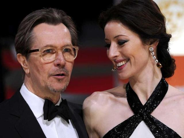 Actor-Gary-Oldman-and-his-wife-Alexandra-Edenborough-arrive-on-the-red-carpet-for-the-84th-Annual-Academy-Awards-on-February-26-2012-in-Hollywood-California-AFP