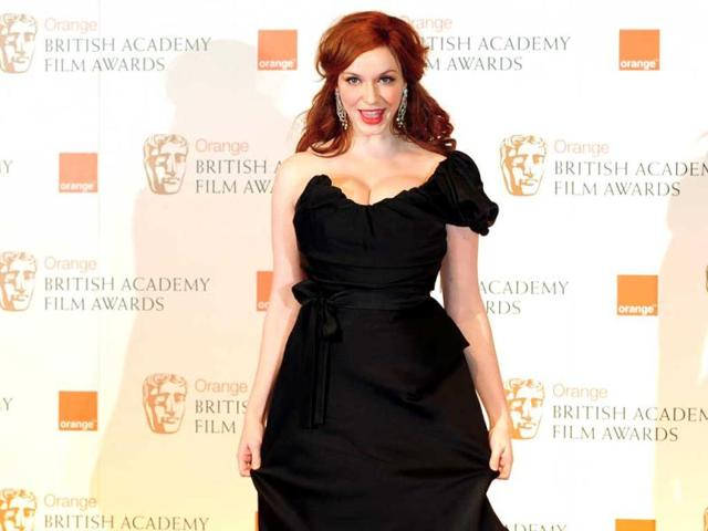 Christina-Hendricks-hourglass-figure-looks-a-tad-toned-down-thanks-to-the-black-gown