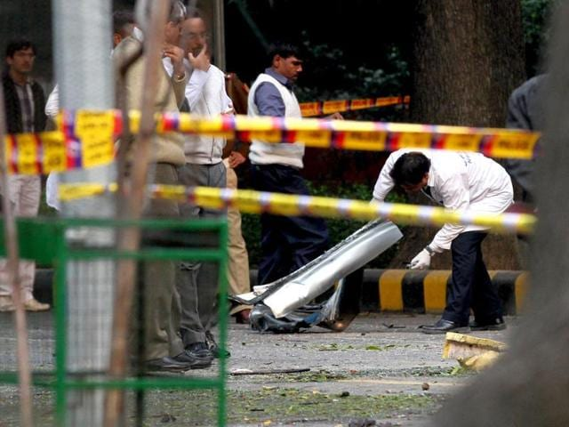 Investigators-examine-a-vehicle-that-exploded-near-the-Israeli-embassy-in-New-Delhi-HT-Arvind-Yadav