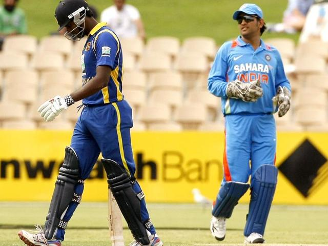 Angelo-Mathews-L-of-Sri-Lanka-walks-back-to-the-dressing-room-after-being-run-out-by-MS-Dhoni-R-during-the-one-day-international-cricket-match-in-Adelaide-Reuters-Regi-Varghese