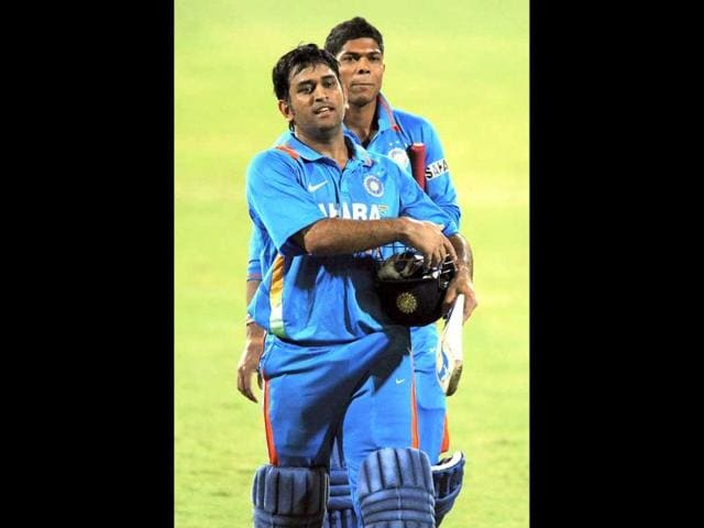 MS-Dhoni-and-Umesh-Yadav-back-leave-the-field-following-the-tied-result-in-the-one-day-international-cricket-match-against-Sri-Lanka-in-Adelaide-AFP-Greg-Wood