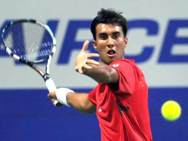 Indian-tennis-player-Yuki-Bhambri-plays-a-return-against-his-Serbian-opponent-Janko-Tipsarevic-during-their-second-round-match-at-the-ATP-Chennai-Open-2011-in-Chennai-on-January-5-2012-Tipsarevic-won-the-match-6-1-6-3-AFP