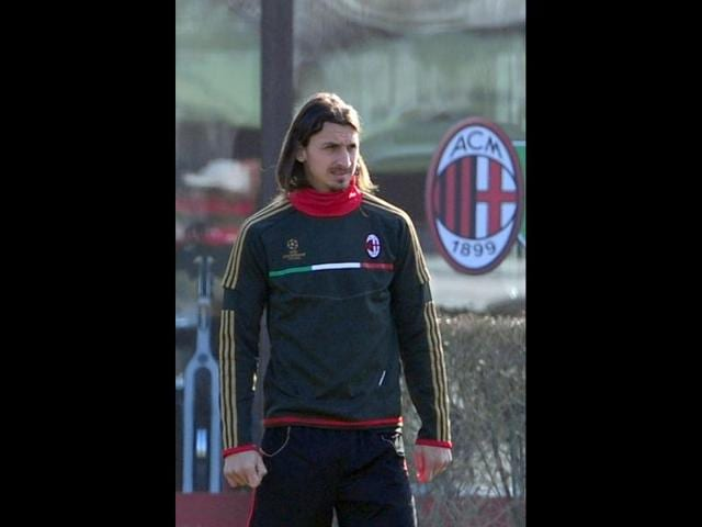 AC-Milan-s-Swedish-forward-Zlatan-Ibrahimovic-looks-on-during-a-training-session-ahead-of-his-team-s-Champions-League-football-match-against-Arsenal-in-their-training-center-of-Milanello-AFP-Giuseppe-Cacace