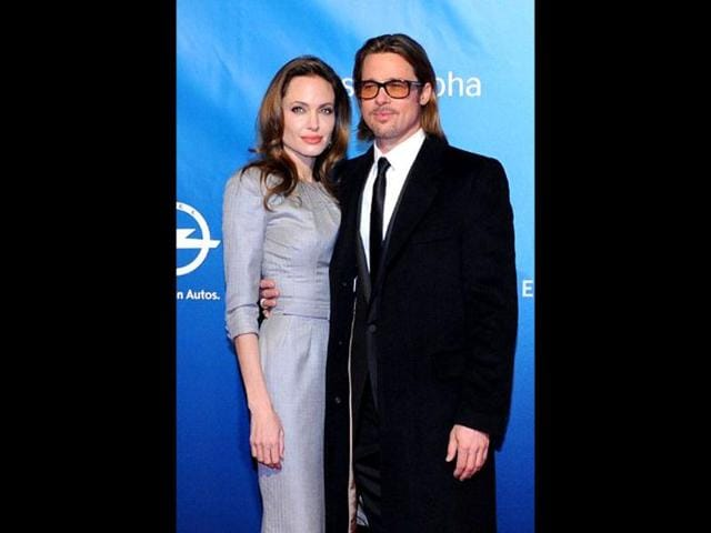 Angelina-Jolie-poses-with-partner-Brad-Pitt-as-they-arrive-for-the-Cinema-for-Peace-gala-in-Berlin