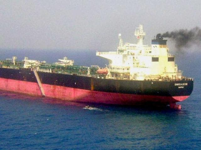An-Italian-diplomat-C-walks-in-front-of-two-Italian-guards-second-row-L-and-2nd-L-of-the-oil-tanker-Enrica-Lexie-as-they-were-taken-into-custody-in-Cochin-Indian-police-took-two-Italian-security-guards-into-custody-on-February-19-after-two-fishermen-were-allegedly-mistaken-for-pirates-and-shot-dead-from-an-Italian-oil-tanker-AFP-PHOTOcaptain-of-the-ship