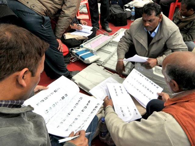 Polling-parties-check-voter-lists-before-leaving-the-Army-Ground-in-Lucknow-to-the-polling-stations-assigned-to-them-on-the-eve-of-the-fourth-phase-of-UP-Assembly-elections