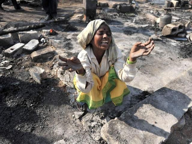 A-woman-cries-after-her-house-was-destroyed-in-a-fire-at-Gundla-Pochampally-in-Medchal-outskirts-of-Hyderabad-AFP-Noah-Seelam