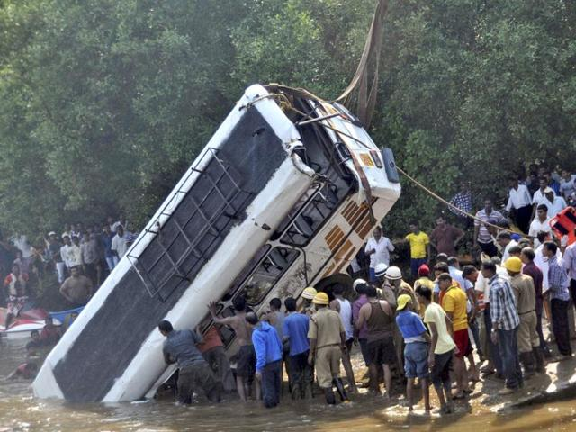 Rescue-workers-pull-out-the-wreckage-of-a-bus-after-it-plunged-into-the-Kalvi-River-at-Aldona-village-near-Panaji-Goa-PTI-photo