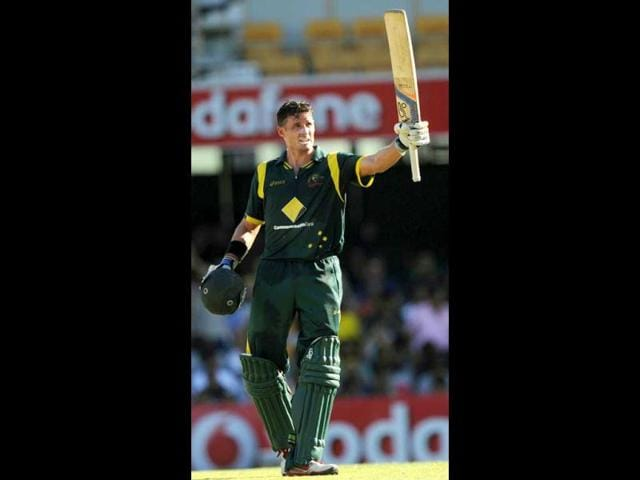Australia-s-Michael-Hussey-raises-his-bat-after-reaching-his-50-during-their-one-day-international-cricket-match-against-India-in-Brisbane-AFP-Photo-Greg-Wood