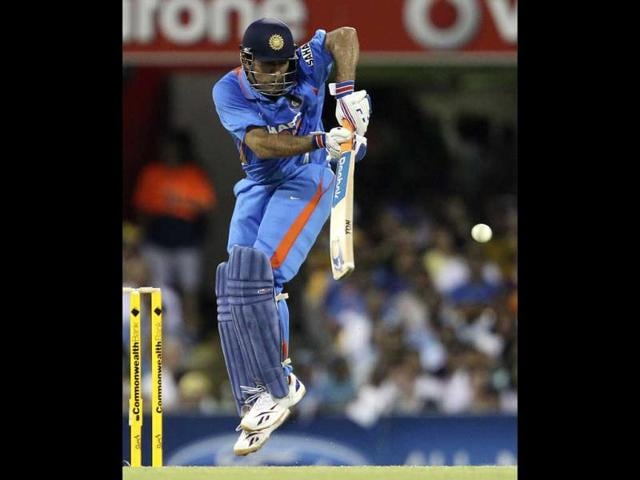 MS-Dhoni-plays-a-shot-during-the-one-day-international-cricket-match-between-Australia-and-India-in-Brisbane-AP-Photo-Tertius-Pickard