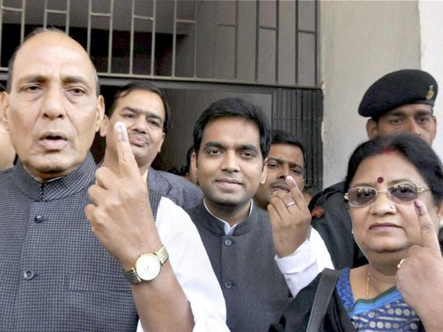 Senior-BJP-leader-Rajnath-Singh-and-his-family-members-show-their-ink-marked-fingers-after-casting-votes-at-a-polling-station-during-the-fourth-phase-of-UP-assembly-polls-in-Lucknow-PTI-Photo-Nand-Kumar