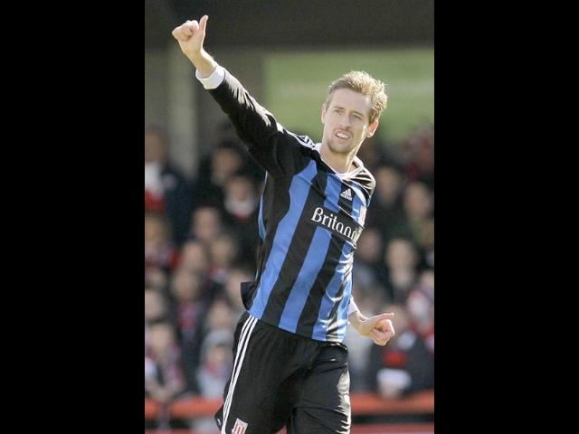 Stoke-City-s-Peter-Crouch-celebrates-his-goal-against-Crawley-Town-during-their-English-FA-Cup-fifth-round-soccer-match-at-Broadfield-Stadium-in-England-AP-Photo-Sang-Tan