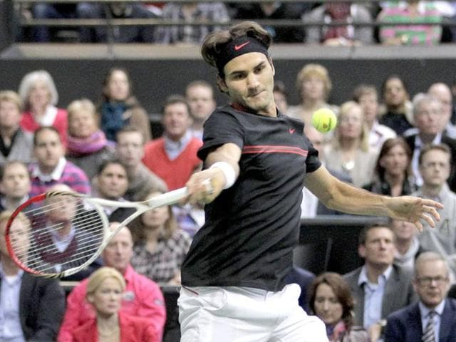 Roger-Federer-of-Switzerland-returns-a-shot-against-Juan-Martin-del-Potro-of-Argentina-during-the-final-at-the-ABN-AMRO-tournament-at-the-Ahoy-Arena-in-Rotterdam-Netherlands-AP-Photo-Peter-Dejong