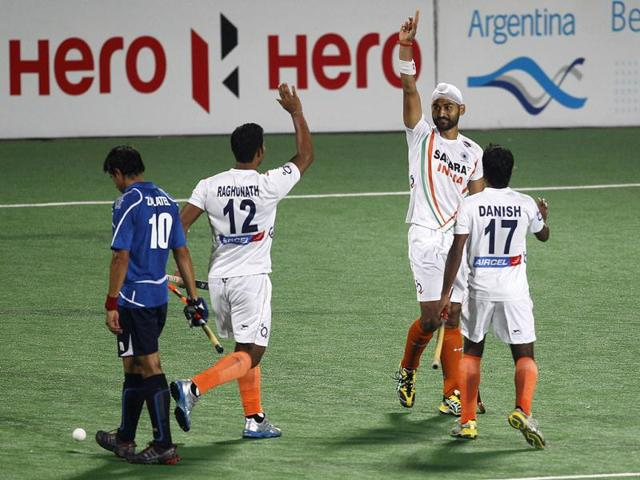 Sandeep-Singh-celebrates-with-teammates-Danish-Mujtaba-and-Raghunath-Ramachandra-Vokkaliga-after-scoring-India-s-fourth-goal-against-Italy-during-their-Olympic-qualifier-hockey-match-in-New-Delhi-AP-Saurabh-Das