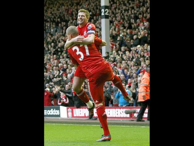 Liverpool-s-Martin-Skrtel-front-is-congratulated-by-teammate-Steven-Gerrard-after-scoring-a-goal-against-Brighton-during-their-English-FA-Cup-fifth-round-soccer-match-at-Anfield-in-England-AP-Photo-Tim-Hales
