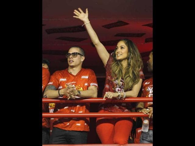 Jennifer-Lopez-waves-to-people-as-she-watches-carnival-parades-with-Casper-Smart-at-the-Sambadrome-in-Rio-de-Janeiro-Brazil-AP-Victor-R-Caivano