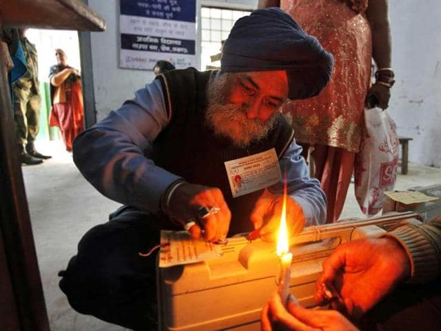 An-election-official-seals-an-electronic-voting-machine-at-the-end-of-polling-at-a-station-in-Lucknow-India-The-fourth-phase-of-polling-in-the-seven-phased-elections-in-India-s-largest-state-Uttar-Pradesh-was-held-Sunday-AP-Rajesh-Kumar-Singh